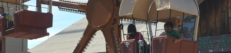 Kids riding Yosemite Sam's Wacky Wagons