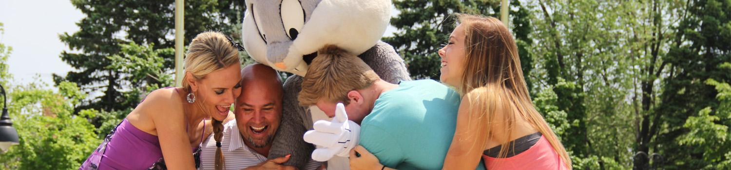 Family of four hugging Bugs Bunny in the summertime