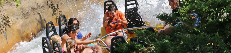 Family in yellow raft splashing down Roaring Rapids