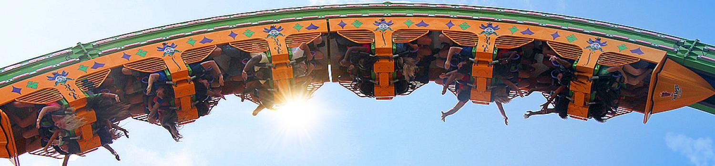 Guest riding THE JOKER Chaos Coaster