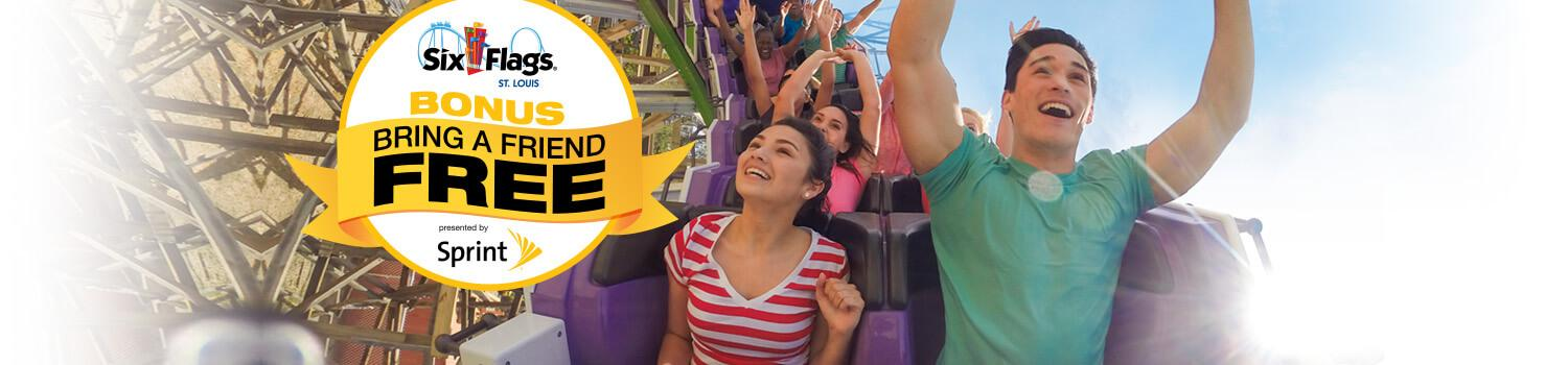 girl and boy on coaster smiling with their hands up