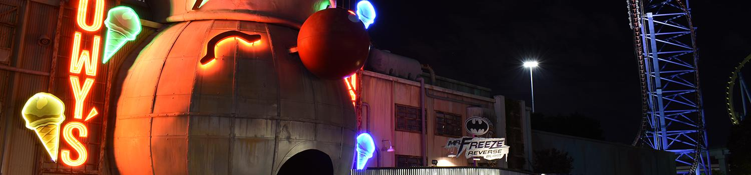 nighttime view of the Mr. Freeze ride entrance