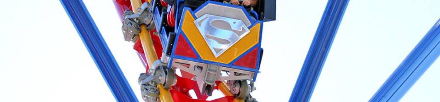 Guests riding Superman coaster