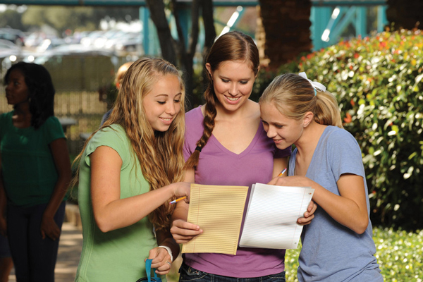 Girls looking at educational event materials