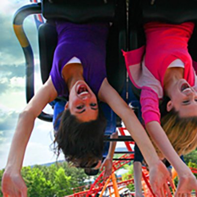 girls riding coaster