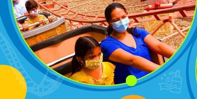 Guest riding a ride with masks on