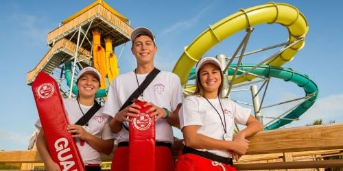 Lifeguards standing in front of water slide