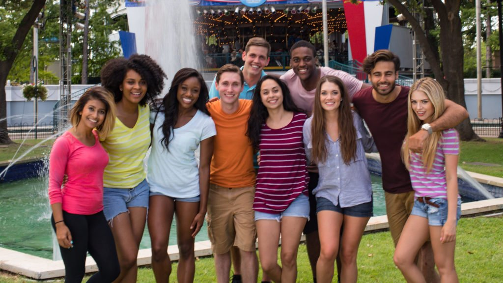 Youth group in front of carousel